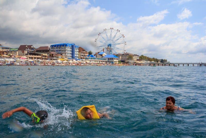 подростки и заплыв бабушки в море стоковое фото rf