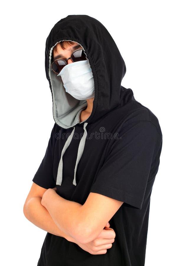 Подросток в маске стоковое фото