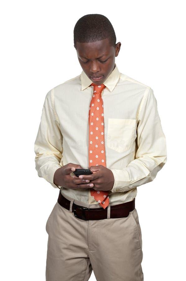 Подросток Texting стоковая фотография