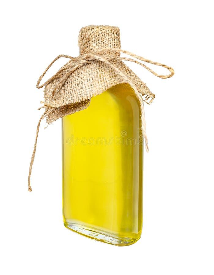 Подсолнечное масло в произведенной стеклянной бутылке изолированной на белой предпосылке стоковые изображения rf