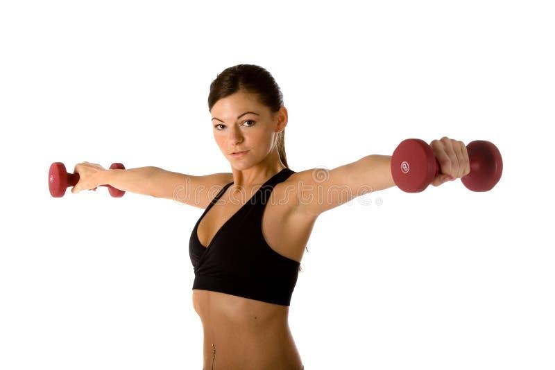 подходящая женщина веса тренировки стоковое изображение