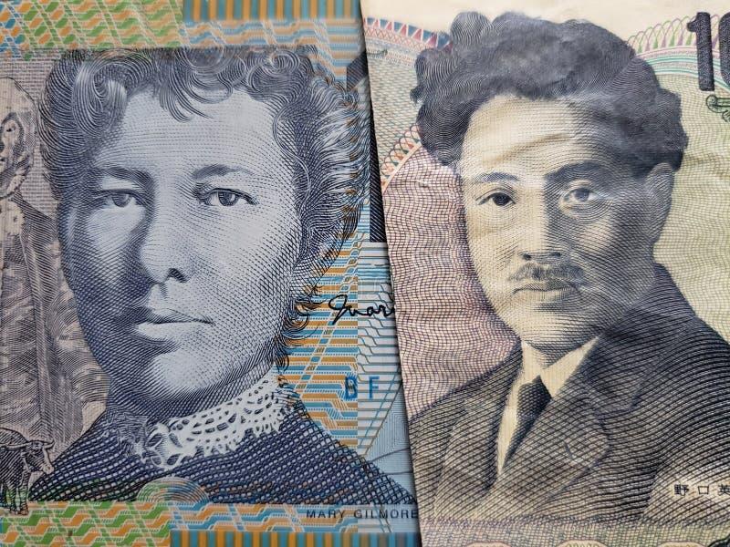 подход к австралийской банкноте 10 долларов и японской банкноте 1000 иен стоковое изображение