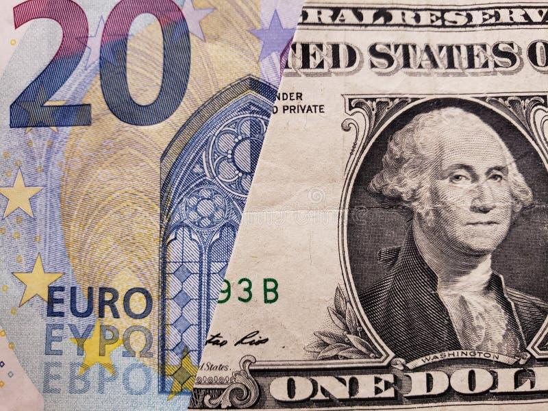 подход к европейской банкноте евро 20 и американской одной долларовой банкноты стоковая фотография