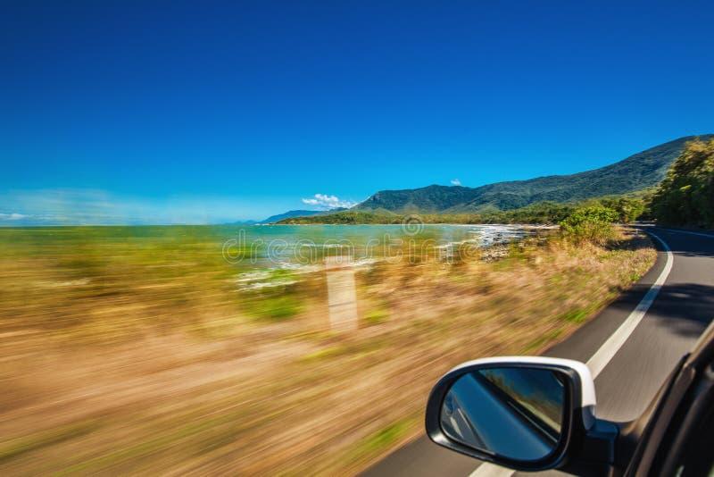 Поездка с нерезкостью движения вдоль пляжа Ellis около бухты ладони и стоковые фотографии rf