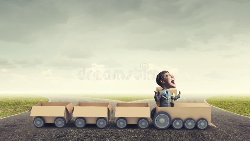 Поезд бумаги езды человека стоковое фото