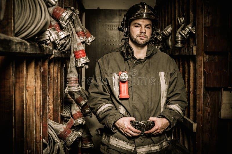 Пожарный в складском помещении стоковые фотографии rf