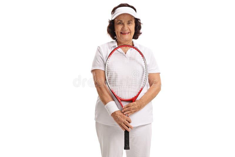 Пожилой теннисист с ракеткой стоковые изображения