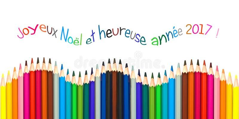 Поздравительная открытка при французский текст знача счастливую поздравительную открытку 2017, красочные карандаши Нового Года на стоковые фото