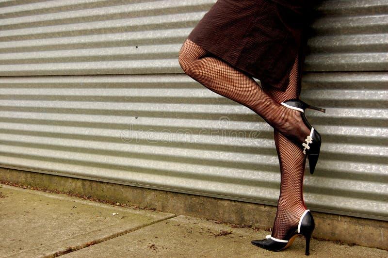 пойманные сетью ноги стоковые фото