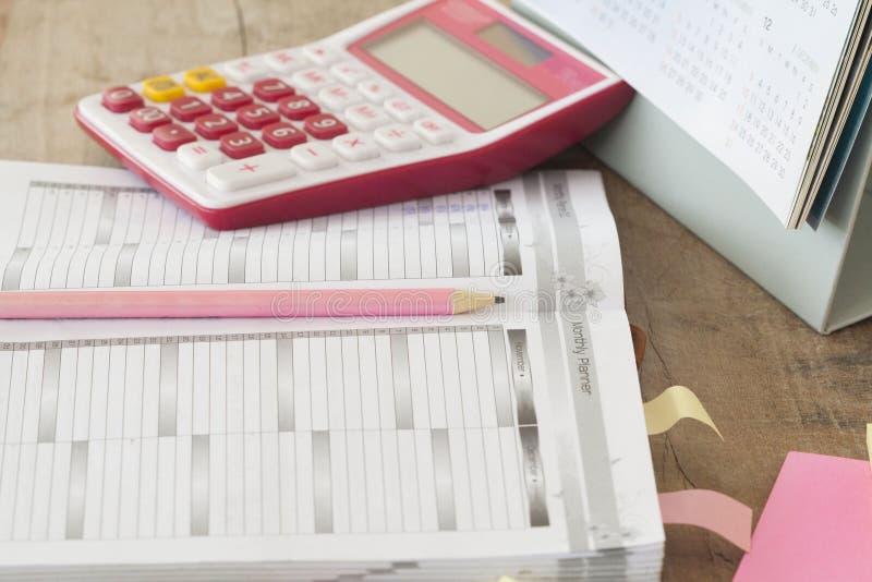 показатель плановика тетради ежемесячный для финансового стоковое изображение