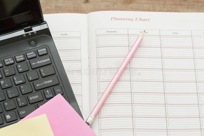 показатель плановика тетради ежемесячный для финансового стоковые фото