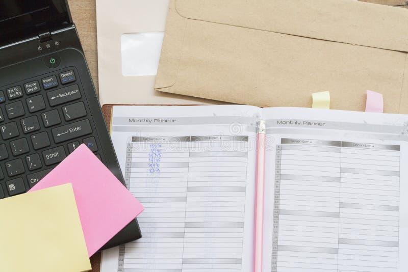 показатель плановика тетради ежемесячный для финансового стоковое фото rf