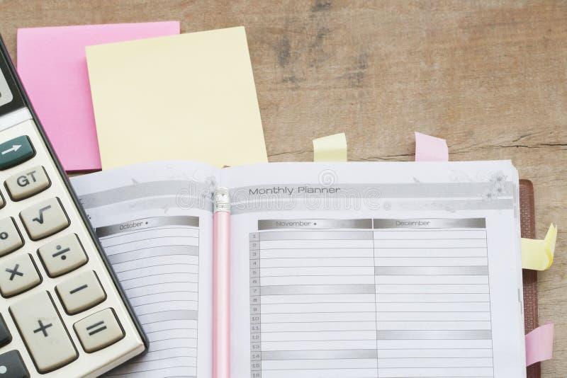 показатель плановика тетради ежемесячный для финансового стоковые изображения