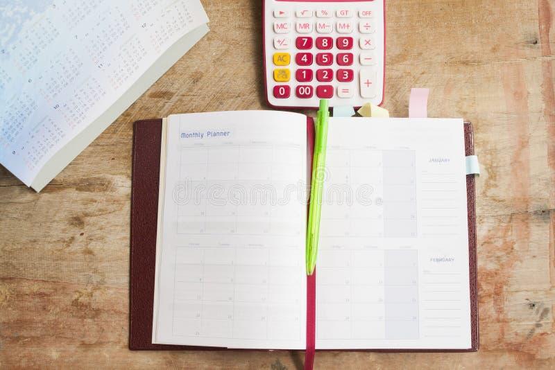 показатель плановика тетради ежемесячный для финансового стоковое изображение rf