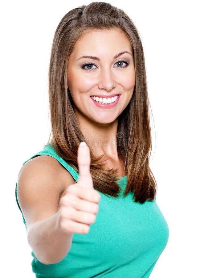 показывать thumbs вверх по женщине стоковые фото