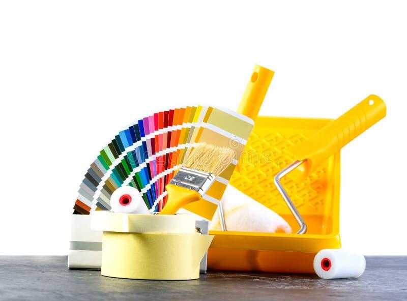 Покрасьте каталог образцов, щетку и ролики краски, различное painti стоковое изображение