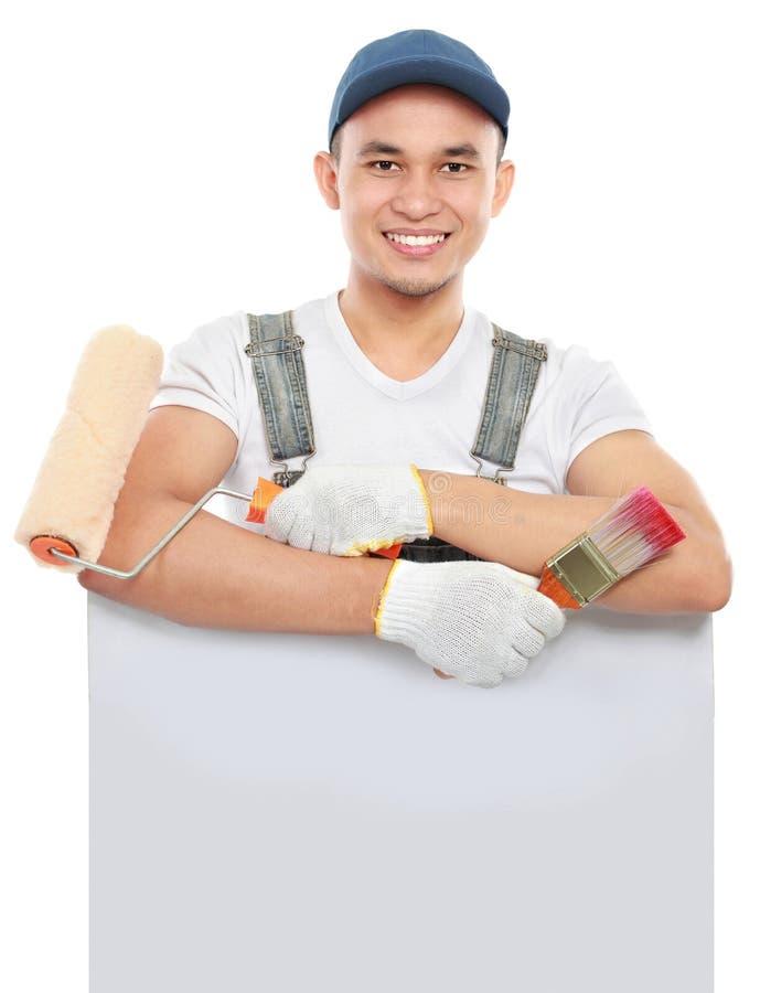 Покрасьте работника с владением инструмента пустое знамя стоковые фотографии rf