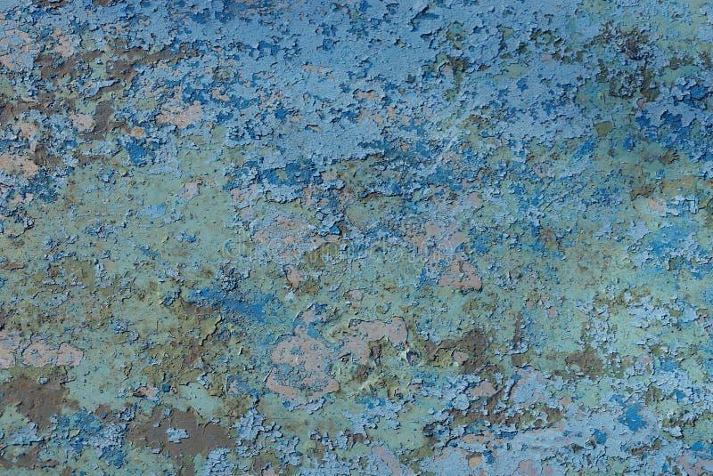 Покрашенная затрапезная текстура краски на старой стене утюга стоковые фото