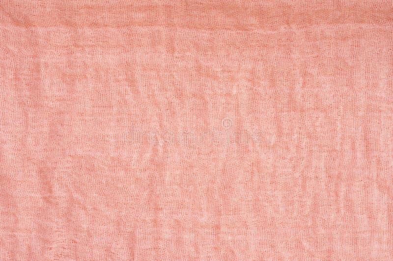 Покрашенная кораллом ткань маркизета стоковое фото
