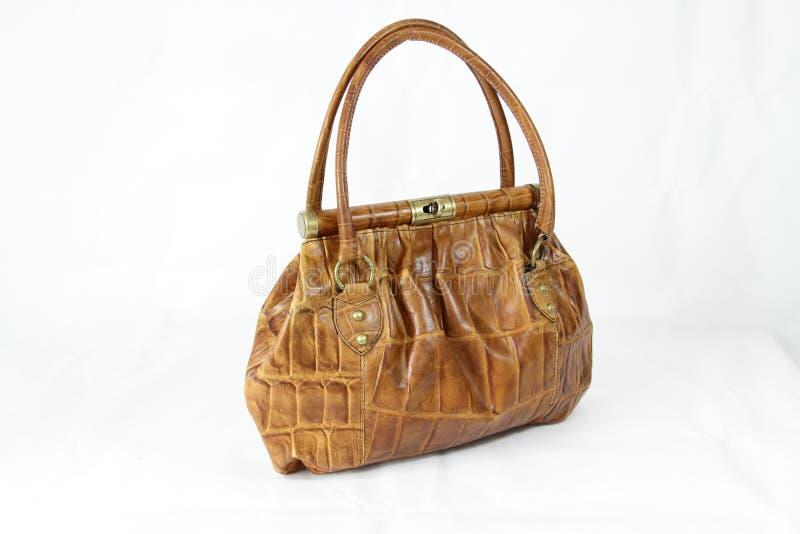 покрашенная коричневым цветом кожа света сумки крокодила стоковое изображение
