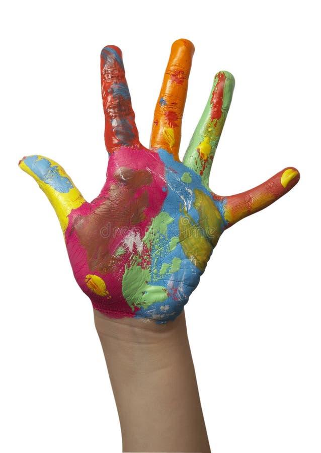покрашенная рука цвета ребенка стоковое изображение rf