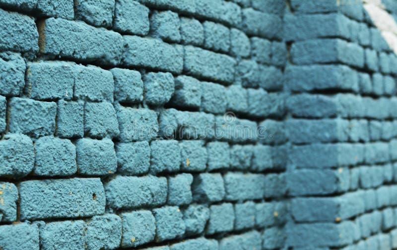 Покрашенная синью текстура предпосылки кирпичной стены стоковая фотография