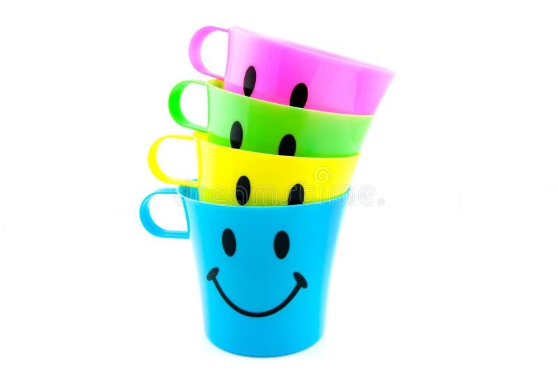 покрашенная сторона чашек счастливая стоковое изображение