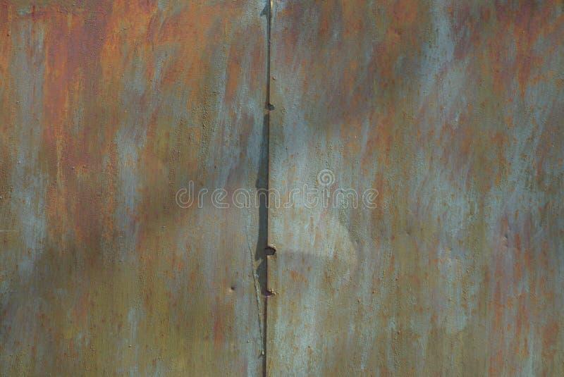Покрашенная текстура металла от старой ржавой стены утюга стоковые фотографии rf