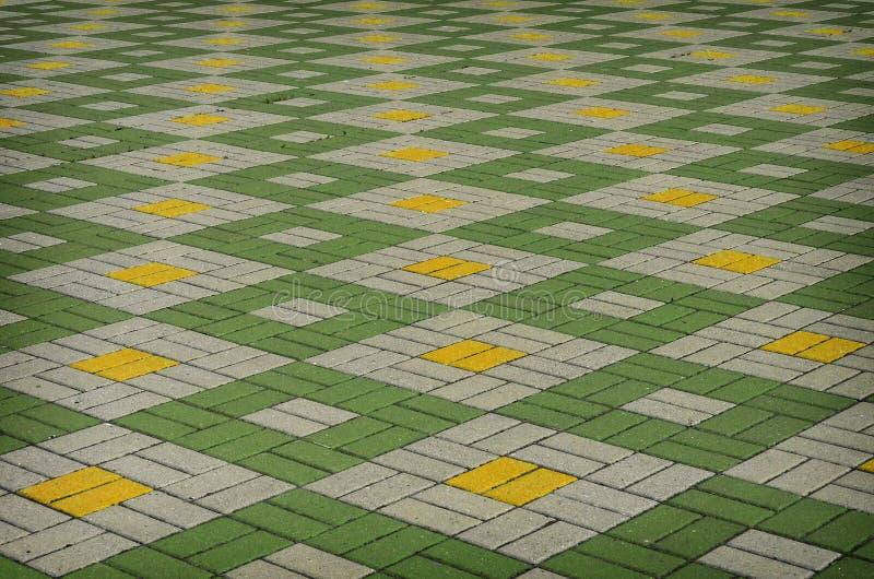 Покрашенная checkered плитка на улице стоковая фотография rf
