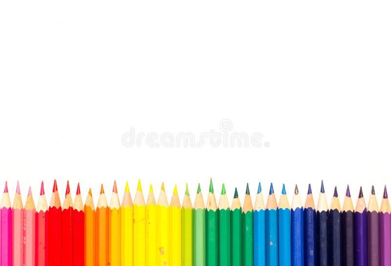 Покрашенные карандаши на белой предпосылке стоковое фото