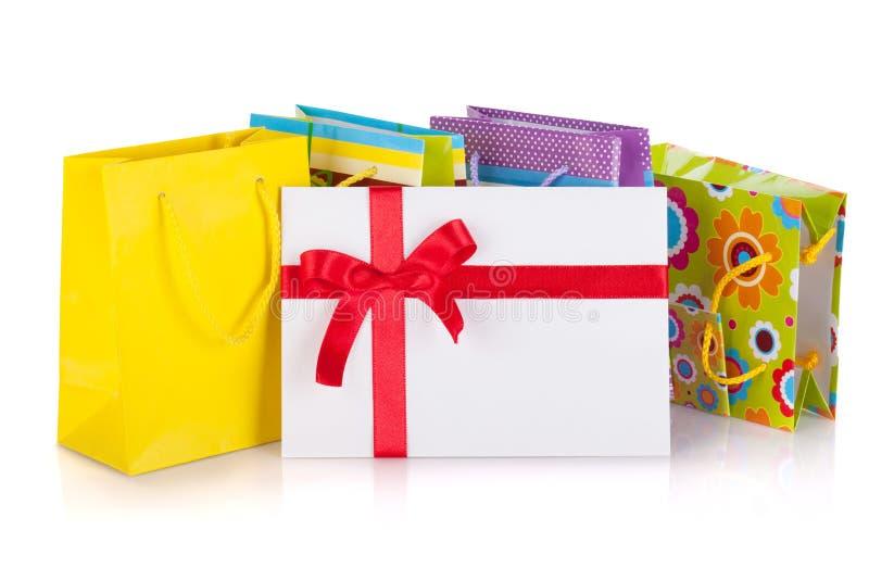Покрашенные мешки, коробка и письмо подарка стоковые изображения rf