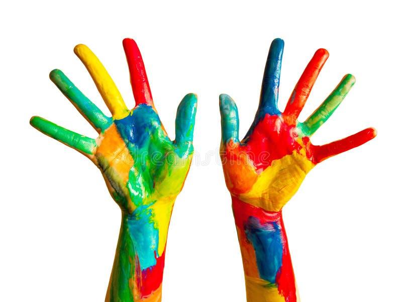 Покрашенные руки, цветастая потеха. Изолировано стоковое изображение