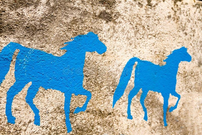 Покрашенные стеной предпосылки лошади стоковые изображения