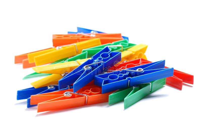 покрашенные clothespins пластичными стоковая фотография rf
