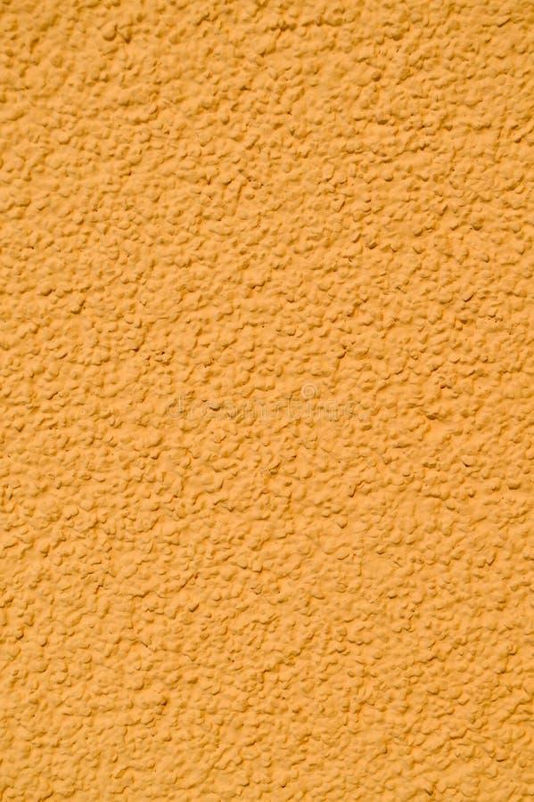 Покрашенный желтым цветом гипсолит внешней стены дома стоковая фотография