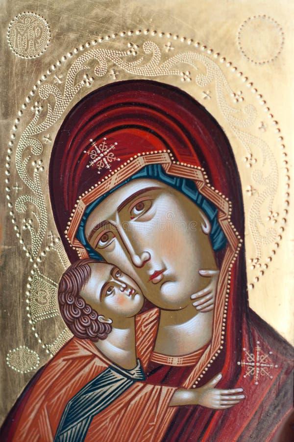Покрашенный значок девой марии и Иисуса Христоса стоковые фотографии rf