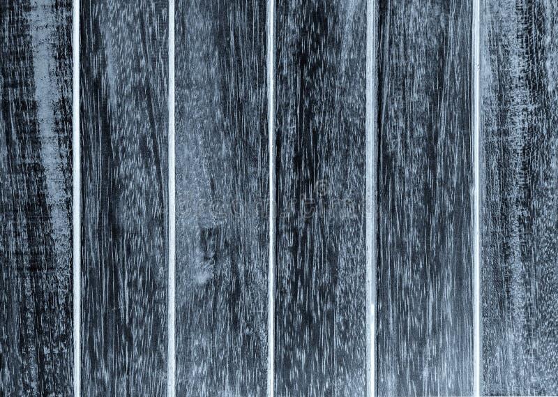 Покрашенный черный цвет на деревянной текстуре с старыми панелями внешними стоковое фото