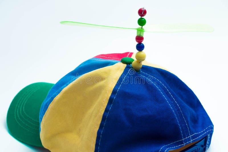 Покройте пропеллер цвета пропеллера вертолета вертолета потехи ребенк шляпы полный стоковая фотография rf