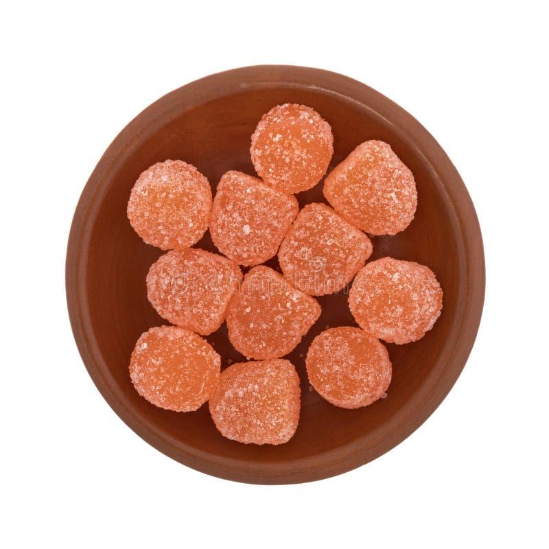 Покрытая сахаром конфета оранжевого кислого падения камедеобразная стоковое изображение
