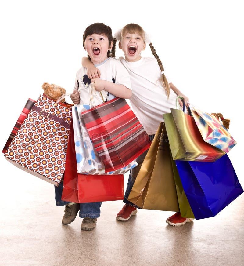 покупка девушки мальчика мешка стоковое фото rf