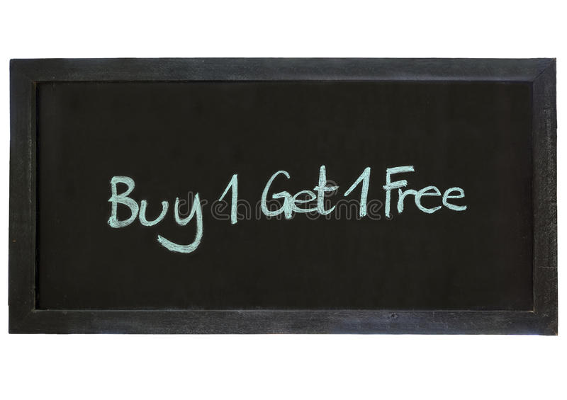 Покупка одно получает один свободный тип на предпосылке доски стоковые изображения