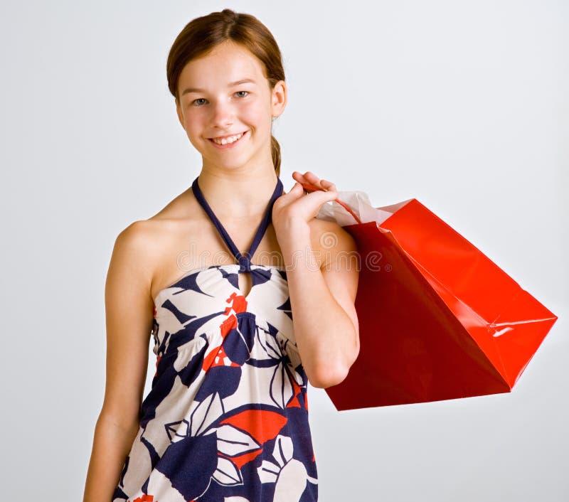 покупка удерживания девушки мешка подростковая стоковая фотография rf