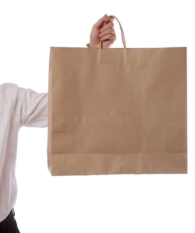 покупка удерживания руки мешка стоковое изображение rf