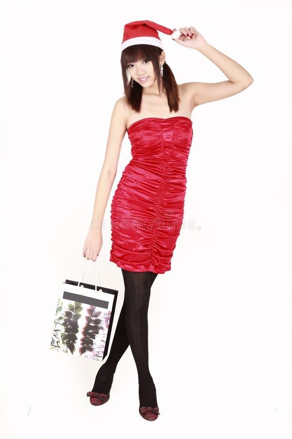 покупка santa девушки Азии стоковые изображения