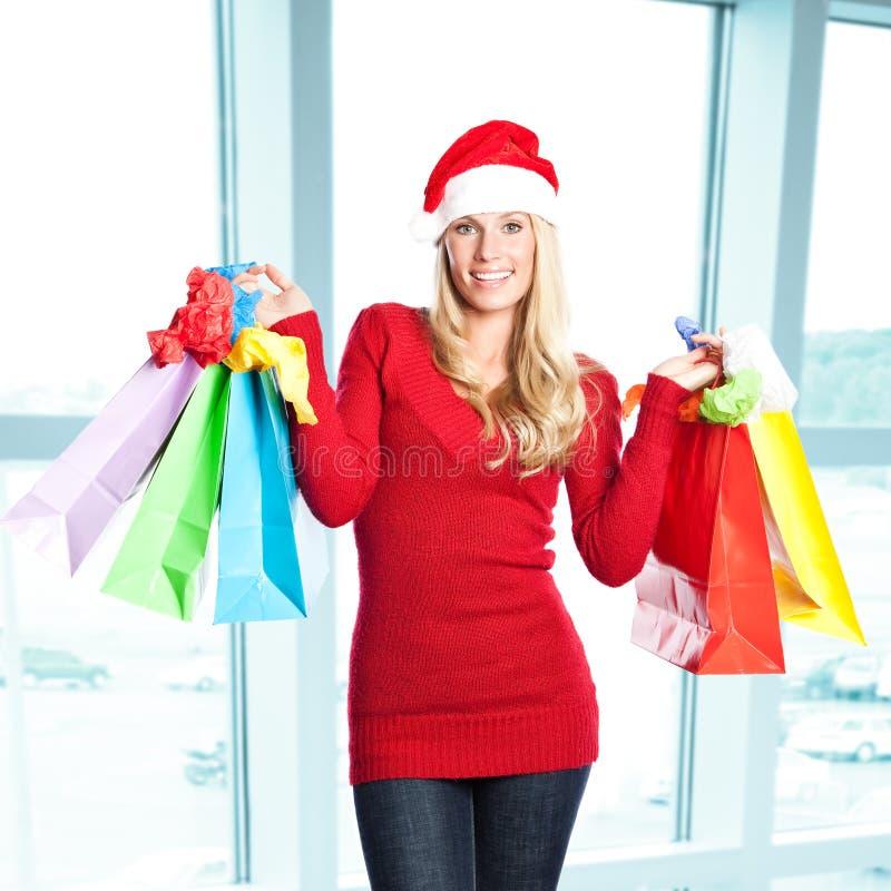покупка santa девушки рождества стоковое изображение