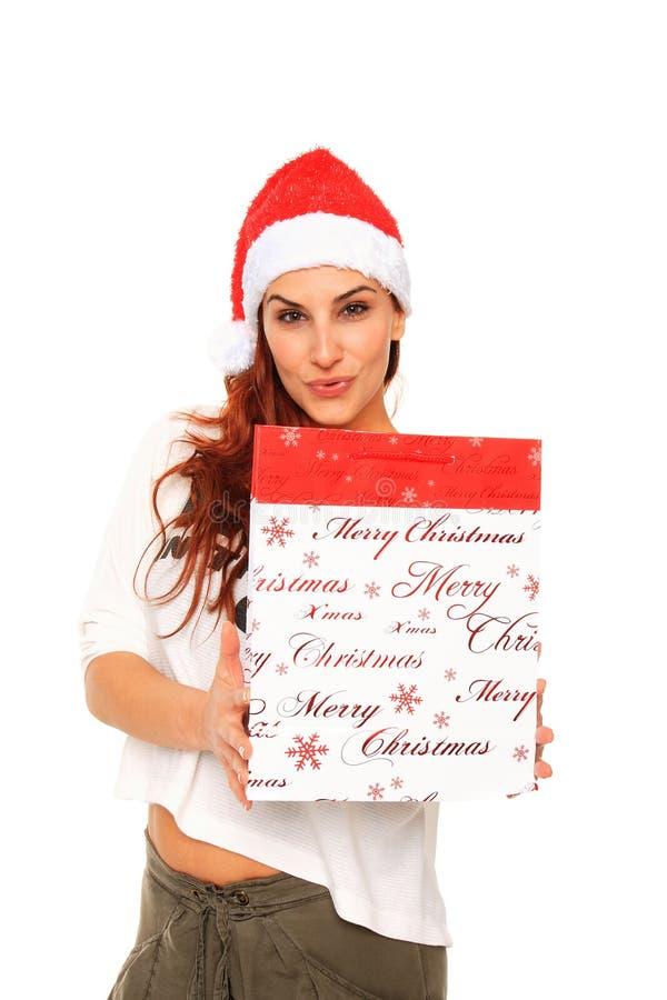 покупка santa удерживания девушки claus мешка стоковые фото