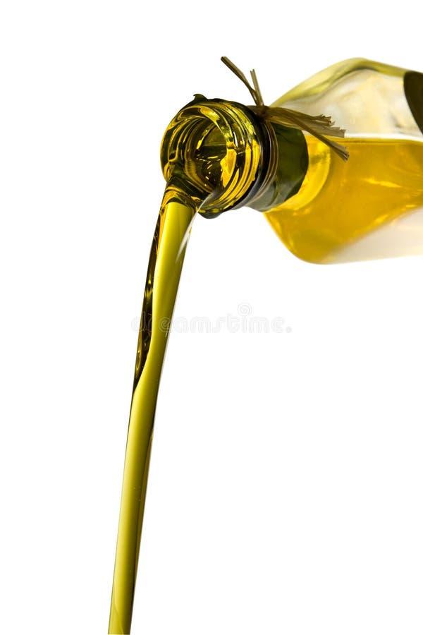 политая оливка масла бутылки стоковые изображения