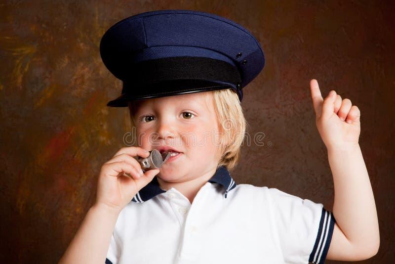 полиции мальчика стоковое фото