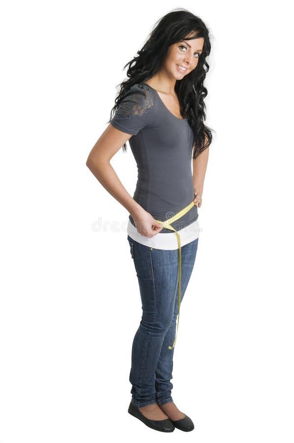 полная девушка ее измерять вальмы стоковая фотография