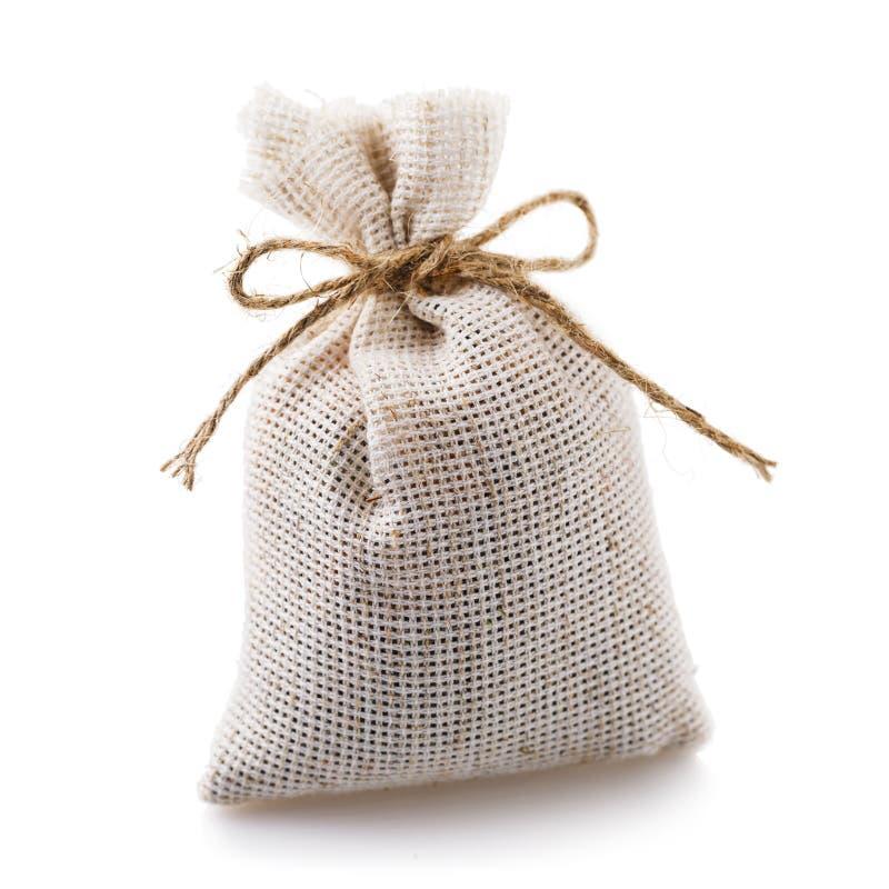 Полная сумка ткани изолированная на белой предпосылке стоковое изображение